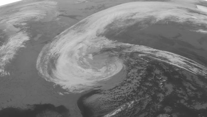 This NOAA satellite image taken Tuesday shows Sandy over much of the eastern United States extending from North Carolina to Illinois into the Northeast with areas of rain.