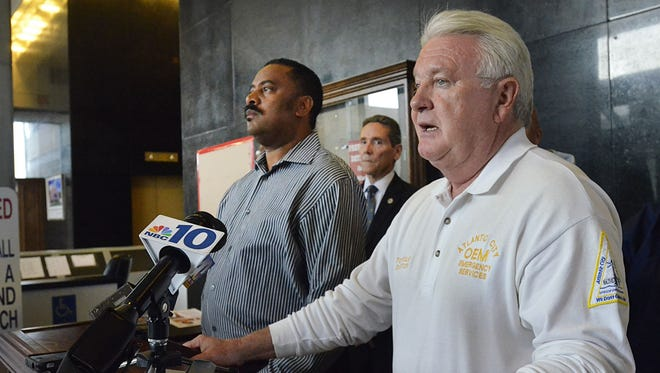 Atlantic City Mayor Lorenzo Langford, left, and Emergency Services Director Tom Foley announce the evacuation of the island and closure of casinos due to Sandy on Saturday.