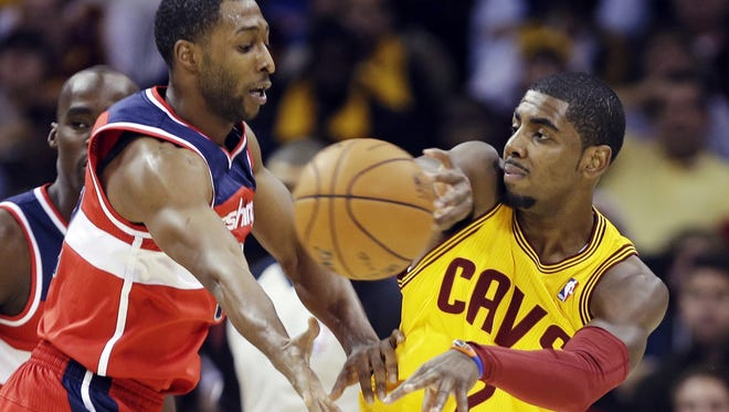 Cavaliers point guard Kyrie Irving passes away from Wizards guard A.J. Price in a 94-84 win Tuesday.