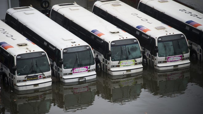 NJ Transit busses sit in flood water as a result of Hurricane Sandy on Tuesday, Oct. 30, 2012 in Hoboken, NJ. (AP Photo/Charles Sykes)