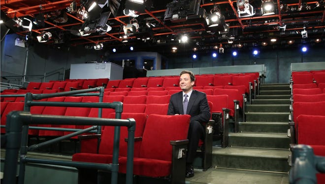 LATE NIGHT WITH JIMMY FALLON -- Episode 724 -- Pictured: Jimmy Fallon sits in an empty audience during the taping of his show on October 29, 2012. No audience was present due to inclement weather caused by Hurricane Sandy. -- (Photo by: Lloyd Bishop/NBC) ORG XMIT: Season:4 [Via MerlinFTP Drop]