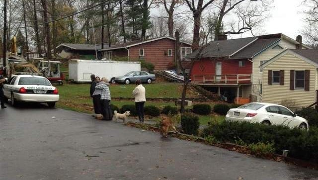 North Salem neighbors comfort each other outside the home where two boys were killed by a falling tree.