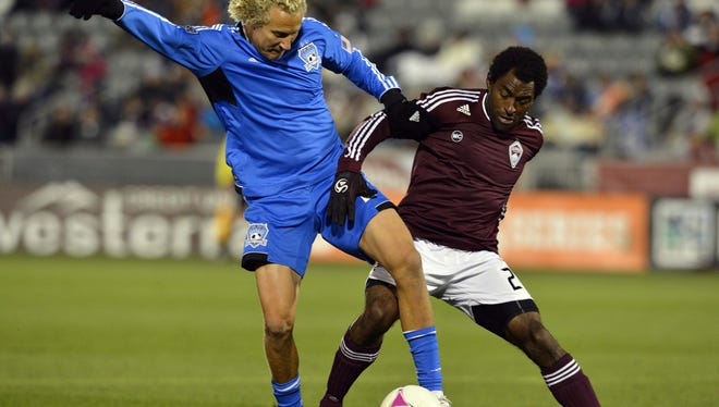 San Jose Earthquakes forward Steven Lenhart (left) and Colorado Rapids defender Marvell Wynne battle for control of the ball in the first half at Dick's Sporting Goods Park on Oct. 6.