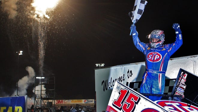 Donny Schatz  waves the checkered flag after winning the prestigious Knoxville Nationals in August.