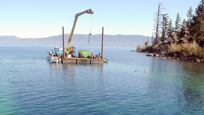 Blankets of rubber lie on the floor of Lake Tahoe at the entrance to Emerald Bay. More than 5 acres of the lake bottom are being covered with the rubber in an effort to smother many of the Asian clams now found near the bay.