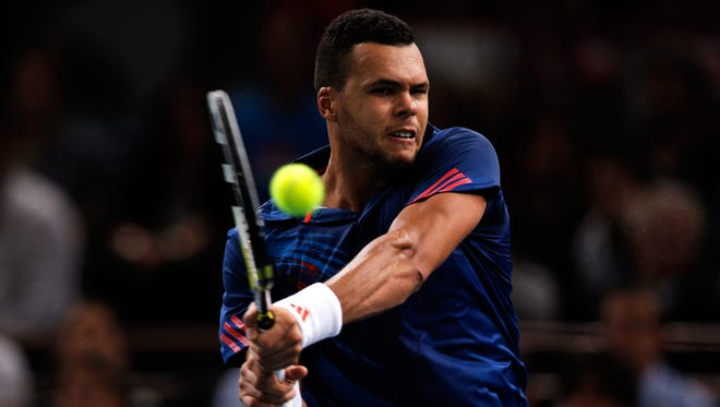 Jo-Wilfried Tsonga of France lines up a backhand during his victory Tuesday against Julien Benneteau of France at the Paris Masters.