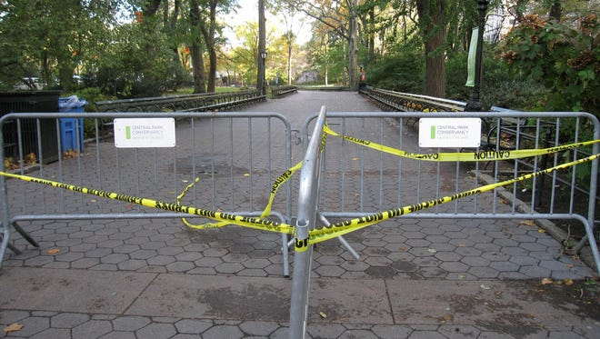 An entrance to Central Park at 59th Street, along the New York City Marathon course, is closed off on Wednesday with all city parks shuttered in the wake of this week's historic storm.