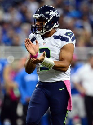 Seattle Seahawks quarterback Russell Wilson celebrates a first down in the first quarter against the Detroit Lions at Ford Field.