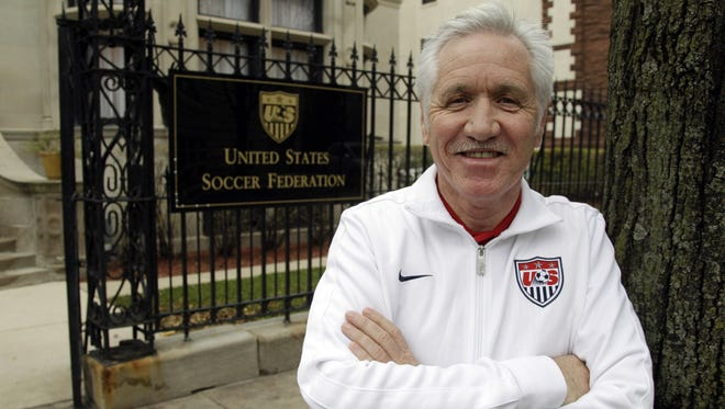 Tom Sermanni, new coach of the United States women's soccer team, poses for a photo outside the United States Soccer Federation Headquarters. Sermanni was hired Tuesday to replace Pia Sundhage, who led the Americans to back-to-back Olympic gold medals and their first World Cup final in 12 years.