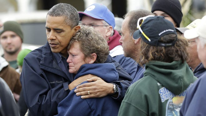 President Obama embraces Donna Vanzant in Brigantine, N.J., on Wednesday during a tour of a neighborhood impacted by Sandy.