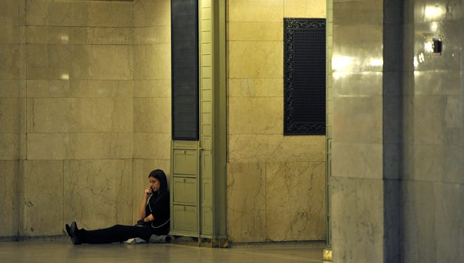 A woman uses her cell phone in Grand Central Station in New York on Wednesday.