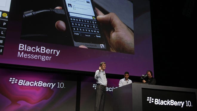 RIM CEO Thorsten Heins gestures while talking about the messenger capabilities of the  BlackBerry 10 at the BlackBerry Jam Americas conference in San Jose, Calif., in September.