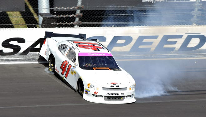 Nur Ali spins during the NASCAR Nationwide Series event at Kansas Speedway. He finished 33rd in his debut.