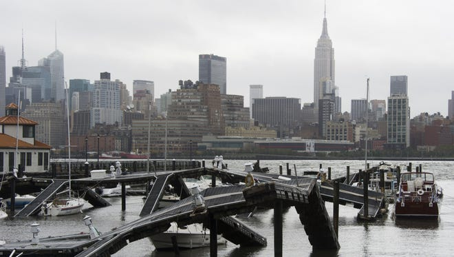 The twisted remains of a Hudson River marina are seen across from New York City as a result of superstorm Sandy on Oct. 30 in Hoboken, NJ.