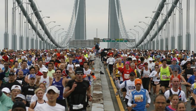 In a file photo from Nov. 1, 2009, runners cross the Verrazano Narrows Bridge at the start of the ING New York City Marathon in New York.