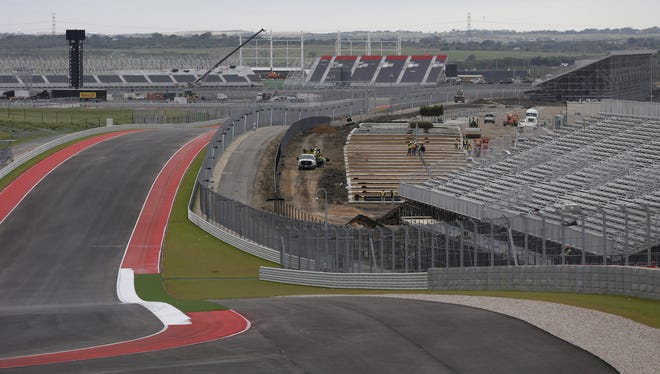 Workers build seating on turn 11 at the Circuit of the Americas race track.