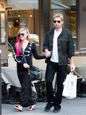 Singer Avril Lavigne and Chad Kroeger are seen strolling on Sept. 13 in Paris.
