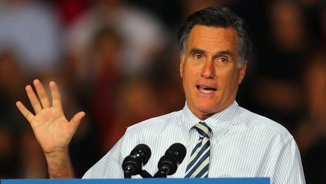 Mitt Romney speaks at a campaign rally in Miami on Wednesday.