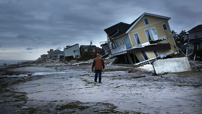 Damage is viewed in the Rockaway neighborhood where the historic boardwalk was washed away during Hurricane Sandy in the Queens borough of New York City.