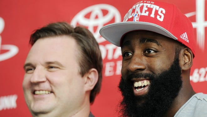 Houston Rockets general manager Daryl Morey, left, and James Harden are all smiles now that the newly acquired guard has agreed to a five-year contract extension.