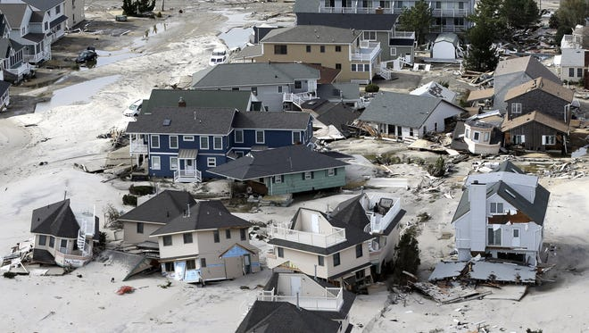 This aerial photo shows destroyed houses left in the wake of superstorm Sandy on Wednesday, Oct. 31, 2012, in Seaside Heights, N.J.