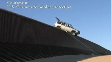 Would-be smugglers were foiled in their attempt to cross the Mexican border into Arizona when their Jeep Cherokee got stuck atop the 14-foot fence.