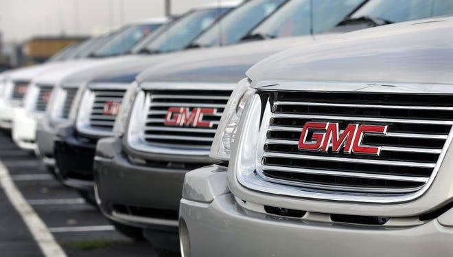 GMC vehicles sit on the lot of a General Motors dealership November 3, 2008.
