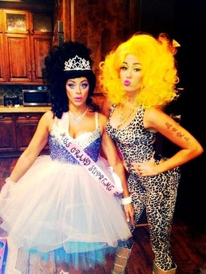 Miley Cyrus poses as Nicky Minaj (right).