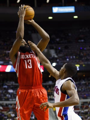 Rockets guard James Harden shoots over Pistons guard Brandon Knight in a 105-96 Houston win Wednesday.