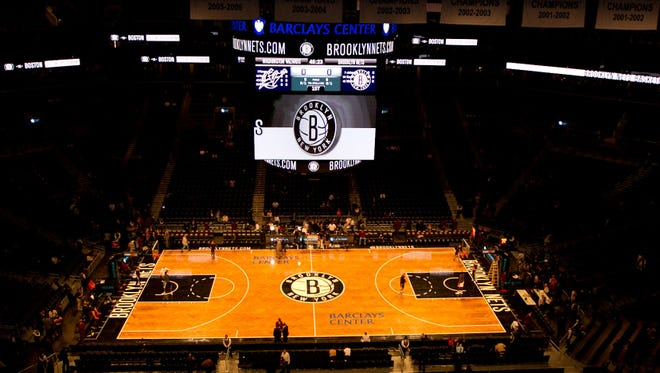 The new Barclays Center will have wait a few more days before NBA basketball is played. Thurdsay's game between the Nets and Knicks has been postponed.