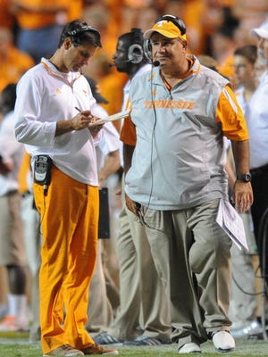 Under head coach Derek Dooley, left, and defensive coordinator Sal Sunseri, the Volunteers are on pace to set a school record for the most yardage and points allowed.