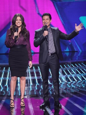 Khloe Kardashian Odom and Mario Lopez host 'The X Factor' on Wednesday.