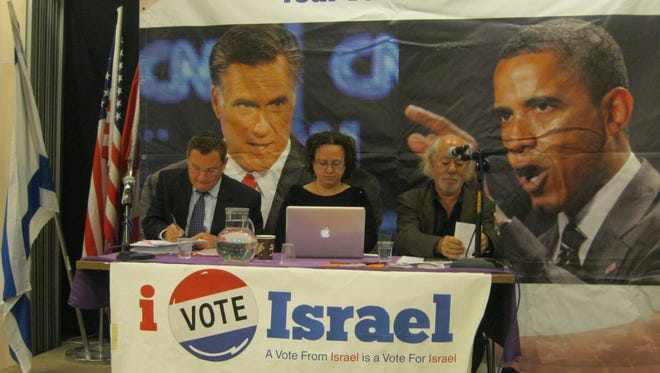 Democratic and Republican representatives debate Sunday at the Jerusalem-based Association of American and Canadians in Israel, drawing a crowd of more than 100 Americans living in Israel.