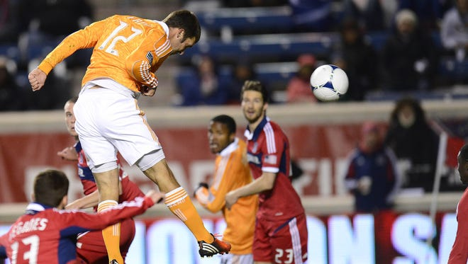 Dynamo forward Will Bruin (12) heads home one of his two goals in Houston's win
