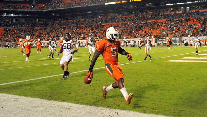 Miami's Mike James (5) scores on a 16-yard reception past past Virginia Tech linebacker Jack Tyler (58) during the first quarter.