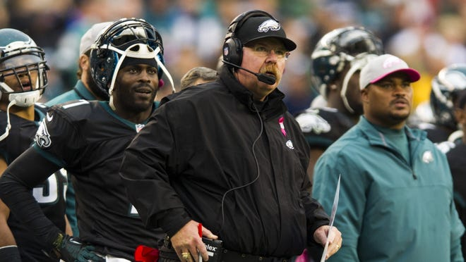 Philadelphia Eagles head coach Andy Reid and quarterback Michael Vick along the sidelines during the third quarter against the Atlanta Falcons at Lincoln Financial Field.