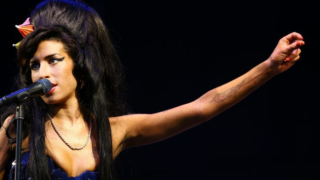 Amy Winehouse performs in 2008.