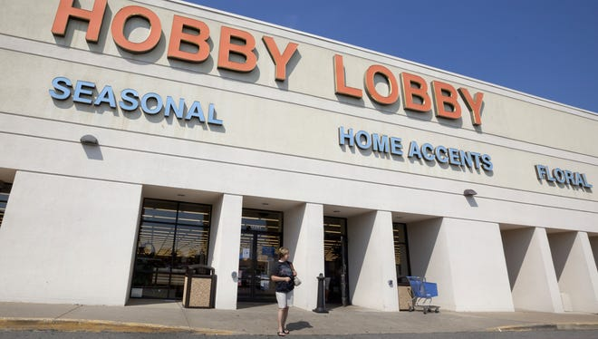 A woman walks from a Hobby Lobby store in Little Rock, Ark.