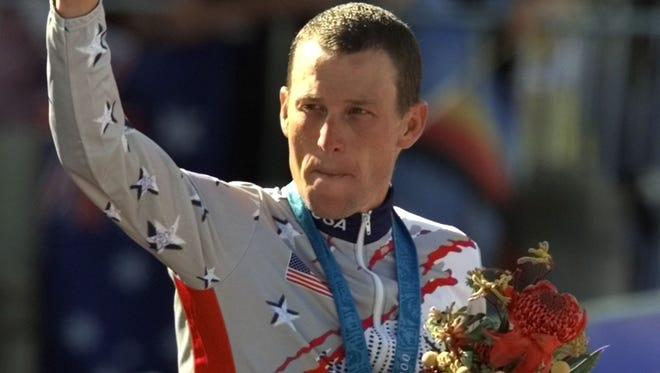 Lance Armstrong won a bronze medal at the Sydney Olympics in 2000 after finishing behind  Viacheslav Ekimov and Jan Ullrich