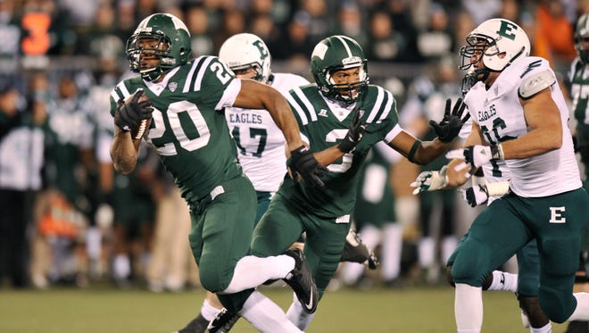 Ohio's Ryan Boykin (20) breaks free for a 57-yard run against Eastern Michigan in the first half. Boykin had 128 yards rushing and one touchdown in 45-14 rout.