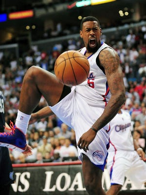 Clippers center DeAndre Jordan celebrates a big basket against the Grizzlies in a 101-92 win Wednesday.