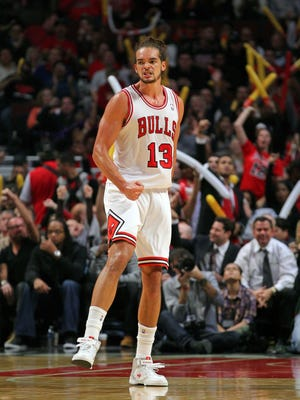 Bulls center Joakim Noah celebrates two of his 23 points in Wednesday's season-opening 93-87 win against the Kings.