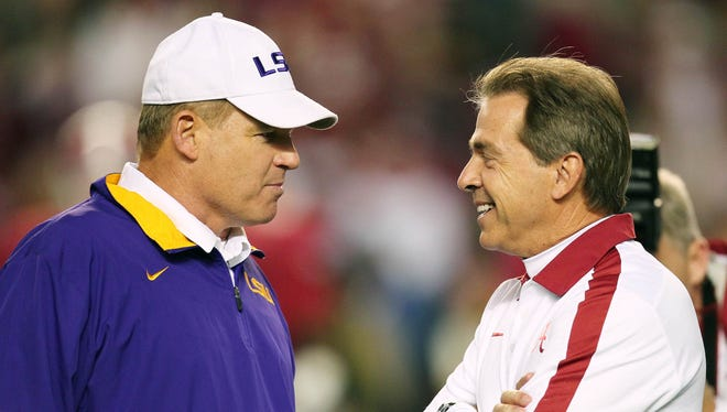 As head coaches, LSU's Les Miles, left, and Alabama's Nick Saban are deadlocked in head-to-head matchups 3-3 going into Saturday's big game.