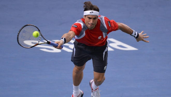 Spain's David Ferrer returns a shot to France's Jo-Wilfried Tsonga during a Paris Tennis Masters Series indoor tournament quarterfinal match on November 2, 2012 at the Bercy Palais-Omnisport (POPB) in Paris.