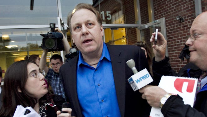 Former Boston Red Sox pitcher Curt Schilling, center, departs the Rhode Island Economic Development Corporation headquarters in Providence, R.I., after he met with the agency to discuss the finances of his troubled video company.