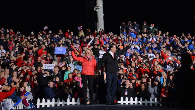 Presidential candidate Mitt Romney and his wife, Ann, arrive Friday night at a rally in West Chester, Ohio.