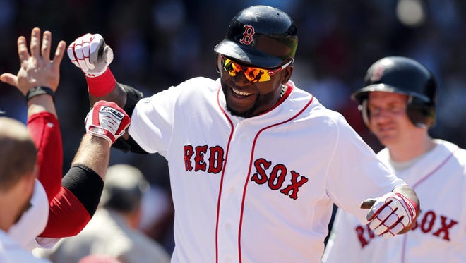 David Ortiz will remain in Boston after reportedly agreeing to a two-year deal with the Red Sox.