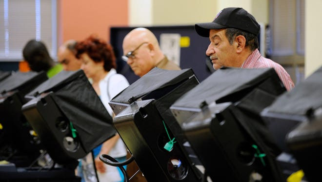 LAS VEGAS, NV - OCTOBER 20:  Voters cast their ballots during the first day of early voting in Nevada at the East Las Vegas Community Center polling station October 20, 2012 in Las Vegas, Nevada. Early voting continues in the battleground state of Nevada until November 2 with election day on November 6.  (Photo by David Becker/Getty Images) ORG XMIT: 153423187 ORIG FILE ID: 154478012
