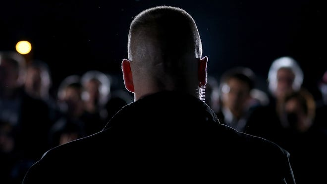 A U.S. Secret Service agent surveys the crowd at a campaign rally in Akron, Ohio.
