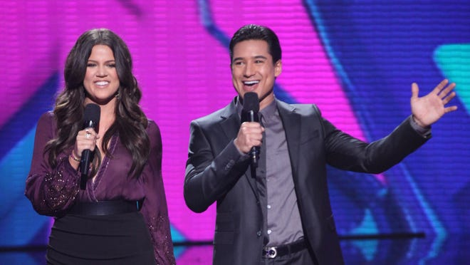 Khloe Kardashian Odom and Mario Lopez host the first live 'The X Factor' show on Wednesday.